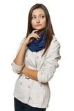 Eftertänksam kvinna som ser till sidan royaltyfria foton