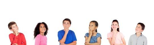 Eftertänksamma barn som tänker om något royaltyfri bild