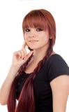 Eftertänksam iklädd svart för tonårs- flicka med en piercing Arkivfoto