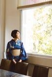 Eftertänksam japansk kvinna Royaltyfri Foto