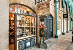 Egar and Snuff Parlour shop with traditional Highlander statue stands guard near entrance. Royalty Free Stock Photography