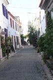 Egeïsch gebied - Tenedos-eiland, kunst, bij de winkels, huizen stock foto's