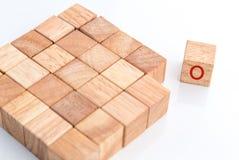 Egenartbegrepp med det wood kubkvarteret jpg Royaltyfri Bild