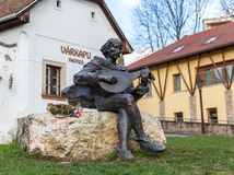 EGER, HUNGARY - MARCH 8, 2016: Statue of a medieval street musician Royalty Free Stock Photography