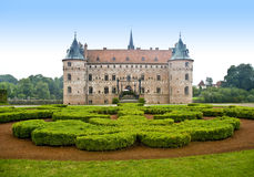 Egeskov castle. Scenic view of exterior of Egeskov castle and landscape gardens, Funen island, Denmark Royalty Free Stock Photos