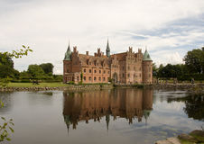 Egeskov castle in Denmark. Egeskov castle in Funen Denmark with a reflection in the water stock photography