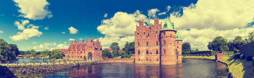 Egeskov Castle, Funen, Denmark. Vintage look. Egeskov Castle, located in the south of the island of Funen, Denmark. Vintage look Royalty Free Stock Photography