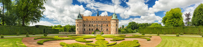 Egeskov Castle, Funen, Denmark. Vintage look. Panorama Of Egeskov Castle, located in the south of the island of Funen, Denmark. Vintage look Stock Photos