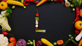 Egetables made letter L. Vegetables made letter L. Alphabet made of vegetables. Autumn harvest generates letters stock images