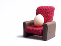 Egg. Sits comfortable in a chair Stock Images