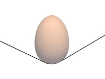 Egg. Is in balance on a thread Stock Photo