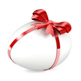 Egg. White Egg with red ribbon and bow Royalty Free Stock Image