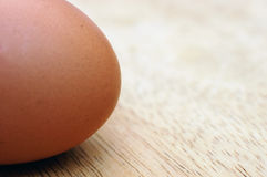 Egg. Lone egg on wood surface Stock Photos