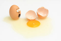 Egg accident. And breaked on solated white background Royalty Free Stock Photo