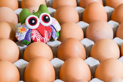 Egg around doll Royalty Free Stock Images