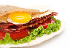 Egg and bacon covered into the pancake Royalty Free Stock Photos