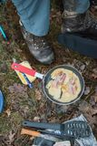 Egg with bacon in fry pan on campsite. Top view royalty free stock photos