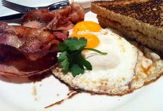 Egg bacon toast. Egg bacon and toast on a plate Stock Photography
