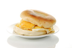 Egg and bagel on a reflective white background Stock Image