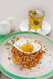 Egg On Baked Beans Royalty Free Stock Images