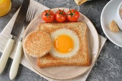 Egg baked in bread. For breakfast Royalty Free Stock Photography