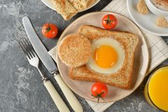Egg baked in bread. For breakfast Royalty Free Stock Photo