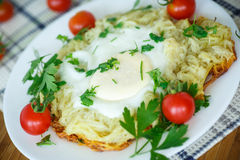 Egg baked in potatoes Stock Images