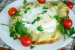 Egg baked in potatoes Royalty Free Stock Images
