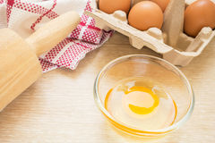 Egg and baking rolling pin Royalty Free Stock Image