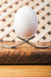 Egg balancing by two forks Stock Photos