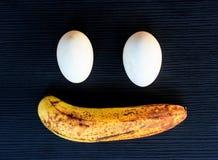 Egg and banana on background Royalty Free Stock Image