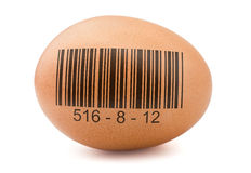 Egg with barcode. Brown egg with generic barcode isolated on white stock photo