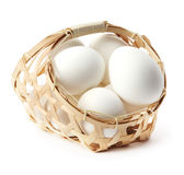 Egg in basket Stock Image