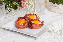 Egg in a basket of bacon still life rural rustic Provence Royalty Free Stock Photography