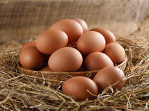 Egg in a basket on the dried grass Royalty Free Stock Photo