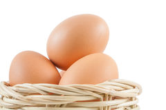 Egg in basket Stock Photography