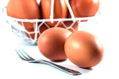 Egg basket. And fork on white background Royalty Free Stock Images