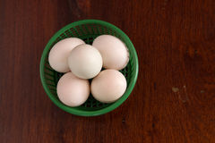 Egg in a basket. Egg in a green basket Stock Photography