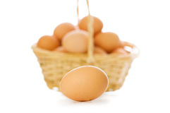 Egg and basket isolated Stock Photos