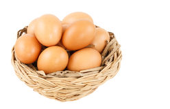 Egg in basket isolated on white background. Egg in basket isolated and white background Royalty Free Stock Photography