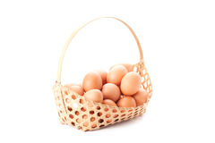 Egg in basket Stock Photos