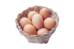 Egg in basket isolated on white background. Royalty Free Stock Photography