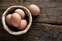 Egg in the basket. On the wood stock photo
