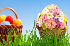 Egg with beads. Easter egg decorated with beads in green grass Stock Photo