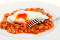 Egg and beans with fork Royalty Free Stock Images