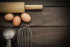 Egg beater, eggs on wooden table. stock photography