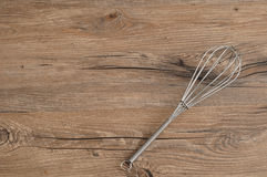 Egg beater,. Whisk,  on a wooden background Stock Photos