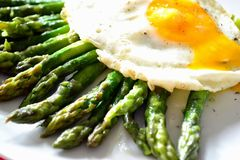 Egg benedict. With cooked asparagus Royalty Free Stock Images