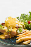 Egg Benedict with french fries. Close up Egg Benedict with french fries Royalty Free Stock Photography