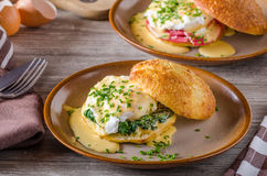 Egg benedict with hollandaise sauce. Fresh pastry royalty free stock photos